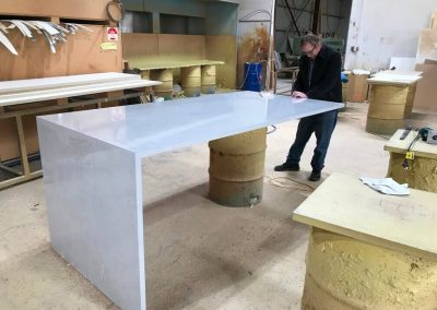 A marble look laminate benchtop with a side leg being finished and prepared for delivery to Unley